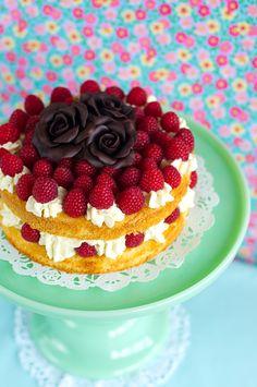 Lulu's Sweet Secrets: raspberries and vanilla mascarpone Bavarian Cream sponge cake decorated with some chocolate modeling roses.