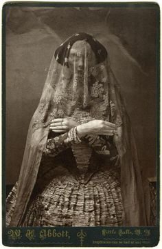 I believe this is a woman in Victorian mourning