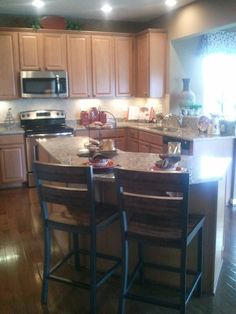a Ryan home-kitchen colors, cabinets, counter top, wood flooring