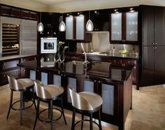 www.joshta.com i 2016 05 dark-brown-varnished-wooden-kitchen-furniture_wooden-kitchen-island_wooden-cabunet-table_wooden-wal-cabinet_grey-fabric-upholstery-wooden-frame-barstool_cream-granite-floor-2-728x576.jpg