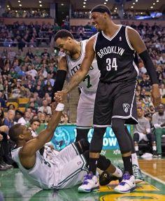 Paul Pierce helping Rajon Rondo get up.  photo from the Boston Globe