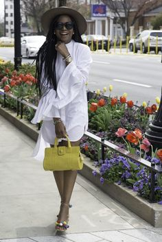 WHITE SHIRT DRESS | STRAW HAT ON SALE! | YELLOW BAG | BLOCK HEEL SANDALS |  WHATCH | PINK STRAP | SUNGLASSES  GET THE JUST RELEASED  AWED BY MONICA SPRING/SUMMER STYLE -ESSENTIALS FOR THE PERFECT WARDROBE  STYLE GUIDE EBOOK TODAY!  The Awed by Monica Spring/Sum