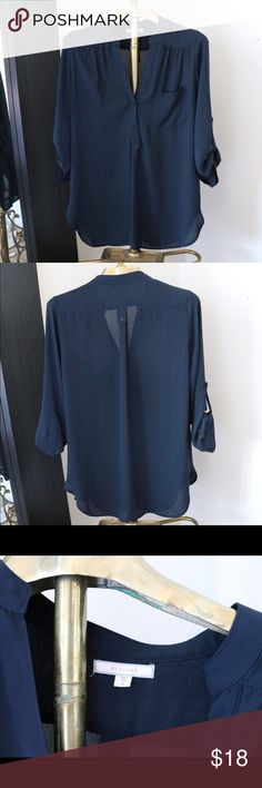 Pleione Blouse Pleione Blouse. Perfect navy blue color. Single Pocket. Flattering button placement. Size small but fits loose and flowy. Great for work but versatile enough to transition to happy hour after a long day!!! Small hole under arm. Easily sewable. Pleione Tops Blouses