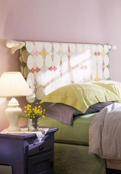 a wood curtain rod and brackets to display a quilt over the bed...