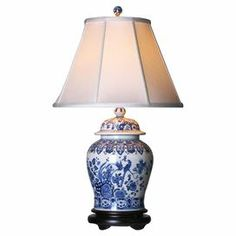"Handcrafted porcelain table lamp with a chinoiserie-inspired motif.    Product: Table lamp  Construction Material: Porcelain and fabric   Color: White and blue   Features:     Handcrafted  Hand-painted antique finish  3-Way light socket      Accommodates: (1) 150 Watt max bulb - not included      Dimensions: 30"" H x 18"" Diameter"