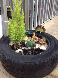 Dinosaur small world in a tyre. Dinosaur small world in a tyre. Kids Outdoor Play, Outdoor Play Areas, Kids Play Area, Outdoor Learning, Backyard For Kids, Backyard Games, Dinosaur Small World, Small World Play, Preschool Garden