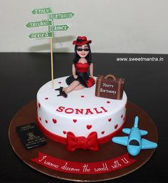 Travel theme customised designer fondant cake with pretty fashionista lady figurine, suitcase, passport for wife's birthday at Pune