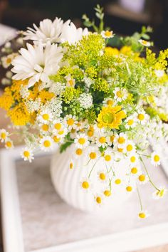 yellow, green, and white arrangement, photo by Mike Olbinski http://ruffledblog.com/backyard-texas-wedding #flowers #centerpieces #weddingflowers