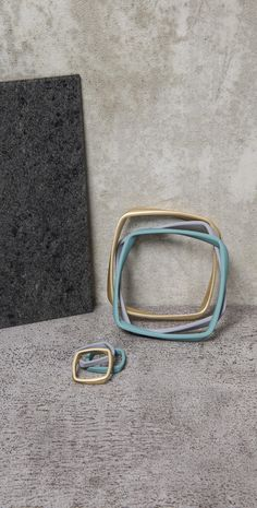 Add light and shade to your look with this Set of Three Seto Twisted Cast Bangles.
