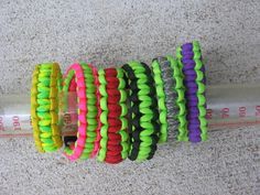 Choice of Lime Green with hot pink, red, ACU camo, day glow, orange or dark green 550 paracord bracelet via Etsy