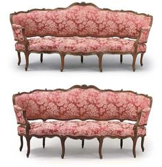 A MATCHED PAIR OF LOUIS XV WALNUT CANAPES EN CORBEILLE