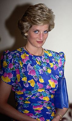 On a visit to Nigeria, Diana pulled out all the stops in a vibrant, multi-coloured floral gown paired with an electric-blue handbag and eyeliner to match. (Photo by Jayne Fincher/Princess Diana Archive/Getty Images) Lady Diana Spencer, Princess Diana Pictures, Royal Look, Royal Style, Sarah Ferguson, Floral Gown, Floral Dresses, Diane, Princess Of Wales