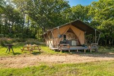 (Quality Unearthed) Quirky Places To Stay With The Kids In The UK: Deerland Safari, Dorset (Perched at the top of a gently sloping meadow on an organic farm deep in the Dorset countryside, Deerland Safari is a stylish two-bedroom safari tent where you'll find no internet or TV, making it ideal for the whole family to make the most of the great outdoors. Cooking is done on a small gas hob, lighting is provided via candles and torches, and there's a charcoal brazier on the deck for chilly...)