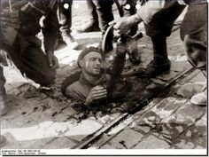 Polish Tragedy: Warsaw Uprising Of 1944. Germans pull out a Armia Krajowa man from a man hole