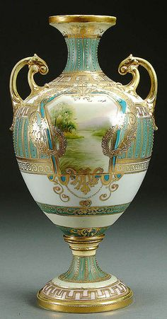 : A NIPPON BOLTED SCENIC PORCELAIN URN circa 1900 WITH HAND PAINTED LAKE SCENES IN GILT CARTOUCHES