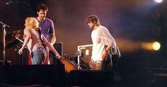 Courtney retrieves broken guitar for Kurt during São Paulo, Brazil Rock Festival on 1/16/93
