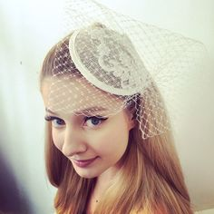 Round base lace and veiled fascinator