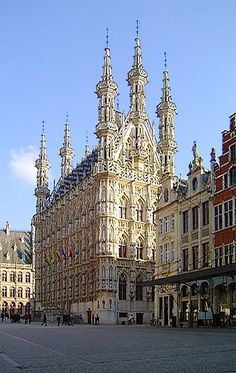 The Grand Place in Leuven, Flanders, Belgium with the Gothic Town Hall to the left and the Grote Markt.  The town hall was built in a Brabantine Late Gothic style between 1448 and 1469, and it is famous for its ornate architecture, crafted in lace-like detail.