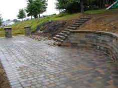 This idea for below the deck. Small retaining wall with a stone patio like this one. Use the stone like the one in front of the garage.
