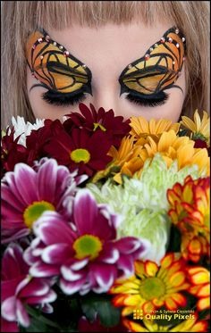 Butterfly inspired eye make-up with crystal accents.
