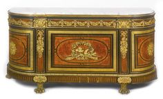 Alfred-Emmanuel-Louis Beurdeley, 1847-1919A Louis XVI style gilt bronze-mounted ebony, ebonized and burr Ambonya commode Paris, second half 19th century, after the model by Joseph Stockel and Guillaume Benneman   lot   Sotheby's