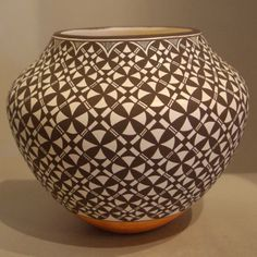 Pueblo:  Acoma  Artist:  Daniel Lucario   Date Created: 2013  Dimensions:  5 1/2 in H by 6 1/4 in Dia   Item Number:  xxack3111  Price:  $ SOLD Description:  Water jar with geometric design New Arrival