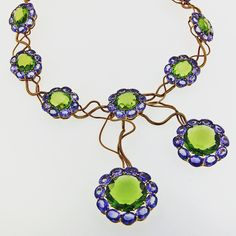 Double face peridot and natural sapphire necklace.  #taffin #taffinjewelry #jamestaffindegivenchy #jamesdegivenchy