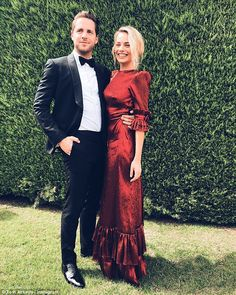 Effortlessly elegant: Margot, 27, looked stunning in a metallic red gown from designer The...