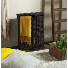 A spacing-saving solution in the bedroom or bath, this pretty and practical hamper is crafted of sustainable kubu rattan in natural brown tones. For quick and easy transfer to the laundry room, this woven rattan hamper comes with a durable cotton liner.
