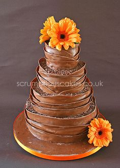 www.scrumptiouscakes.co.uk (585) - 4 tier milk chocolate wrap wedding cake with fresh orange gerberas.