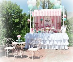 This Ice Cream Party is styled to resemble an ice cream parlor! Ice Cream Truck cake, bistro style tables, ice cream sundae flower arrangements