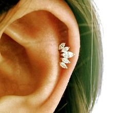 CZ Crown cartilage earring, tiara tragus earring, crown conch earring, dainty crystal cartilage piercing, rose gold stud, Most popular item by ShopOrigamiJewels on Etsy https://www.etsy.com/listing/273357710/cz-crown-cartilage-earring-tiara-tragus