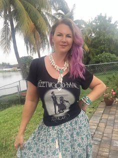 Trunk Ltd, Fleetwood Mac graphic tee, paired with Spell and the Gypsy collective Kombi skirt in green. Necklace is by Ouroboros Designs and can be found on Free People website #cr8tivewanderlust #melissastees #trunkltd #fleetwoodmac #graphictee #spelldesigns #spellandthegypsy #purplehair #summerstyle #cowrieshellnecklace #turquoise #curls #fashionblogger #dlitefultrends #style #bohochic #boholuxe #gypsy