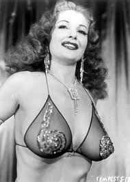 Tempest Storm! Famous for her tiny waist and large bust.