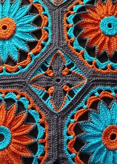 Crocheted Daisy Afghan, turquoise and orange, inspired by Spanish tile work.