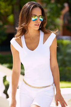 The so sexy shoulder cutouts and v neckline make this figure-flattering knit top unforgettable. Cotton/spandex Imported Machine wash