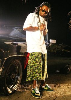 Lil Wayne shooting a music video, while wearing a baggy t-shirt and camo shorts in 2005.