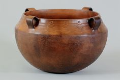 Four handled cook pot. Cherokee coil built with walnut textured bottom.