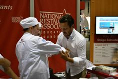 Fabio Viviani is helping the students with their chef jackets