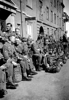 German Wehrmacht soldiers of the 2nd Battalion, 137th Regiment of the 2nd Division wait on the streets of occupied Denmark before being deployed to Norway. Frederikshavn, North Denmark Region, Jutland, Denmark. May 1940.
