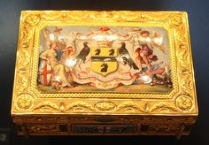 Freedom Box with Arms of Admiral Earl Howe    1794-5  London, England; mark of James Morisset (1738-1815). Chased and enamelled gold, commemorating the 'Glorious First of June', a naval battle fought between Britain and France off the coast of Brittany in 1794.    Victoria & Albert Museum, London