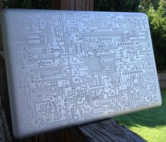 Laser engraved MacBook Pro by Laurie LS Wright (DoodleBugDezines), via Flickr