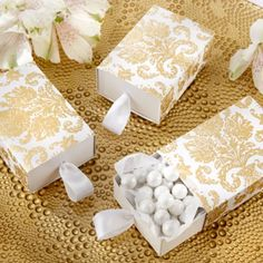 Your special day deserves the best. Find it in the form of these elegant treasures gold damask favor boxes.