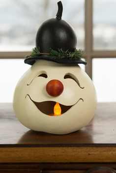 Walter - Ornament Walter - Ornament <br> This adorable snowman head is white in color with a black gourd hat and has an adorable orange nose. Approximately in diameter and 3 tall. It is the perfect ornament to hang on a tree. Elf Christmas Decorations, Christmas Elf, Holiday Crafts, Christmas Ornaments, Xmas, Decorative Gourds, Hand Painted Gourds, Crafts To Make, Diy Crafts