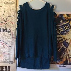 S&S Cut Sleeve Sweater Edgey sweater in a beautiful dark teal/ blue with 5 square cutouts in each sleeve. There is a bit of wear and tear around the cutouts but no actual damage. S&S Sweaters Crew & Scoop Necks
