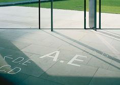 kronen carré stuttgart  signage system  stuttgart 2001    the kronen carrée quarter is a complex of buildings accessed via a hall. the linear architectural elements have been developed into a graphic code. the lines follow a matrix and their thickness and length are varied in line with a musical principle. they signal information, tie the different typographical levels together, and lend aesthetic appeal to their collision protection function. in keeping with the structural architectural…