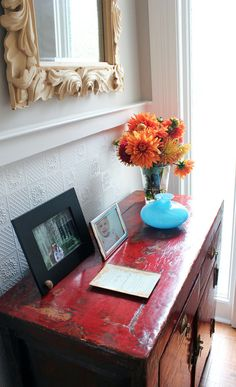 Back in the entryway, pops of color set the tone for her charming home.