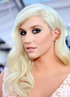 Kesha works the ear cuff at the American Music Awards.