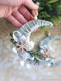 Frosted twine moon with snowflake and greenery ornamentThese little crescent moon decorations are so easy and festive.Christmas Songs In Yoruba Language Christmas Gifts For Sports diy christmas ornaments that bring the joy homelovr – Artofit Diy Christmas Ornaments, Christmas Projects, Handmade Christmas, Holiday Crafts, Angel Ornaments, Ornament Crafts, Christmas Tree Toy, Christmas Holidays, Christmas Music