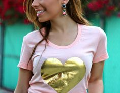 Statement earrings paired with a graphic tee for Spring! www.stilettobeats.com